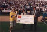 Donation presentation at Wilfrid Laurier University Homecoming 1992