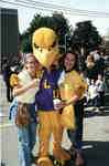 Golden Hawk mascot with two women