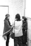 Three women standing in hallway, Waterloo Lutheran University