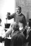 Robert Basso and students in classroom