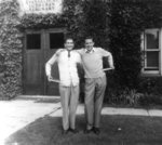 Two students in front of Willison Hall, Waterloo College