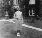 Student in front of Willison Hall, Waterloo College