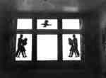 Window decorated with silhouettes