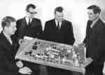 Four men with architectural model