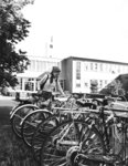 Woman at bicycle rack, Wilfrid Laurier University