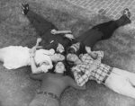 Wilfrid Laurier University students laying on grass