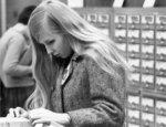 Woman using card catalogue Waterloo Lutheran University Library