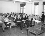 Flora Roy and students in classroom