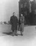 James Clark and Flora Roy standing in front of  Willison Hall, Waterloo College