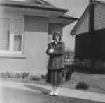 Waterloo College student Doreen Sanderson standing in front of a house