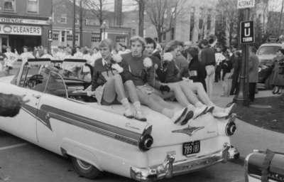 Waterloo College cheerleaders in Homecoming Parade, 1957