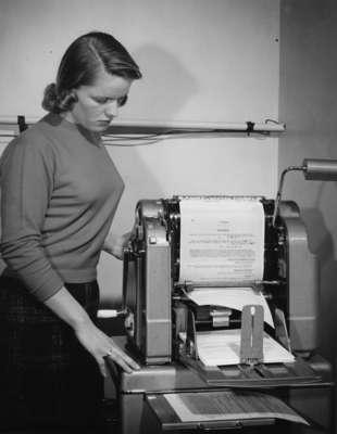 Waterloo College student Doreen Sanderson using a Gestetner stencil duplicator