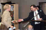 Chris Nighman presenting rare book to Sharon Brown