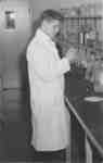 Waterloo College student in a science laboratory