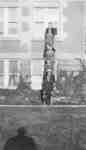 Seven men standing on a ladder
