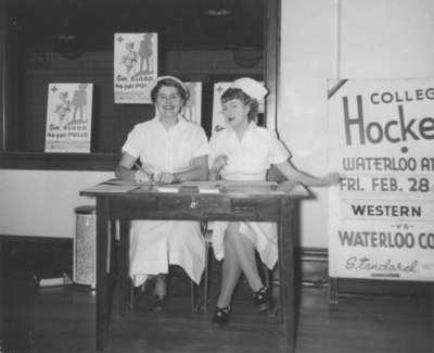 Two nursing students sitting at a table