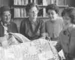 Women's Auxiliary members holding a quilt