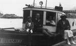 "Lunn family at Whyte Cliff on the boat ""Mr. Brunswick"" owned by Mt. Rundell"