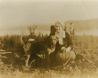 "Mrs. DePencier and her dog ""Major"" on Baby Mountain (later Sentinel Hill)"