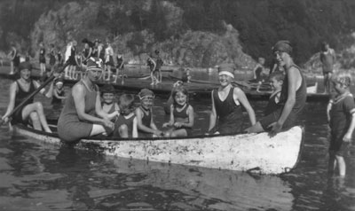 Mrs. Lunn (L) and Mrs. Allison (R) canoeing with children in Horseshoe Bay