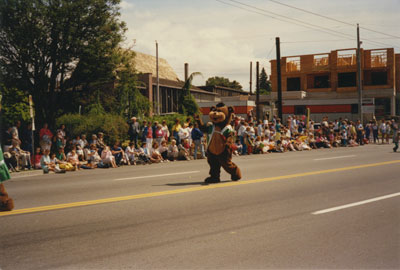 Community Day Parade (figure in bear costume)