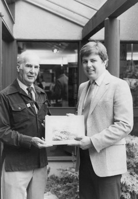 Don Mills Accepting a Book Donation