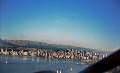 Aerial View of English Bay, Downtown & North Shore Mountains