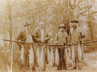 Dan Sewell with world billiard champions at a fishing weekend in Horseshoe Bay