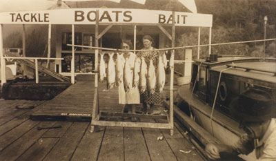 Two ladies in front of their fishing catch at Sewell's Marina