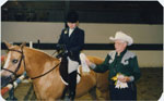 George Thompson presenting ribbons at a horse show
