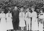 The Kloepfer family, pioneers of St. Anthony's Roman Catholic Church, with Father Boniface O.F.M.