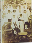 Archbishop Duke with first holy communion class