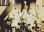 Father D. J. Casey and the first communion class