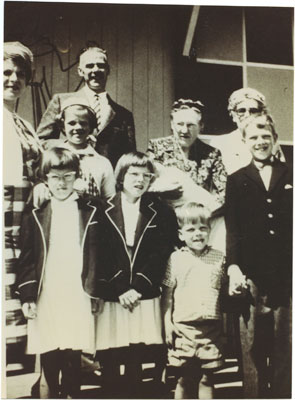Mr. & Mrs. Wilf Gildersleeve and family outside St. Anthony's new church