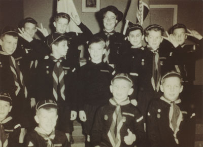 Eta Herchenrath, Cubmaster, and her cub group in St. Anthony's Church Hall