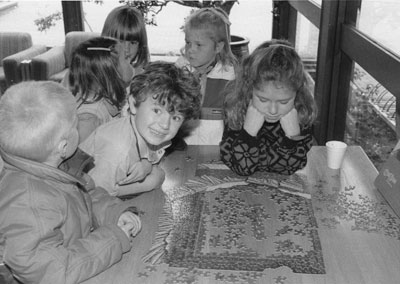 Children Working on a Puzzle