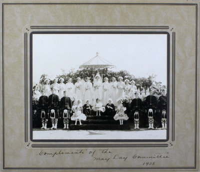 Group photograph of May Day celebration and ceremony platform, 1938.  May Queen, Gladys Wilson, Royal Chancellors, Ian MacDonald (left), Albert Fletcher (right) and others.