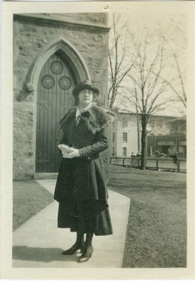 Loretta Weis in front of Church of the Good Shepherd