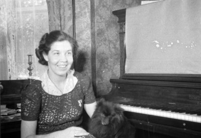 Unidentified Woman and Dog, c.1936