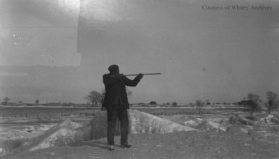 Unidentified Man Shooting a Rifle, c.1915