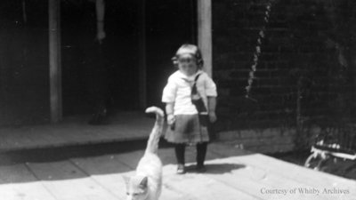 Unidentified Child and Cat, c.1915