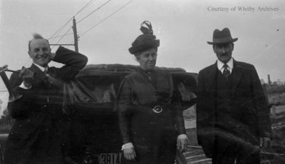 Three People Standing At The Back Of A Car, c.1915