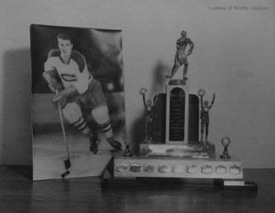 Photograph of Ross Lowe and the Ross Lowe Memorial Trophy, 1956