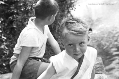 Two Unidentified Children Sitting By A River, c.1936