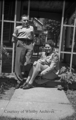 Unidentified Man standing with Woman in Uniform, c.1940s