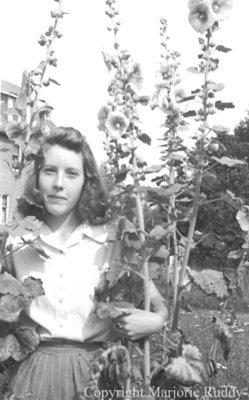 Unidentified Child in Flowers, c.1945