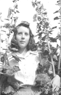 Unidentified Child in Flowers, c.1945