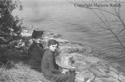 Unidentified Women Sitting By A Lake, April 27, 1941