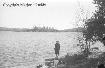 Unidentified Woman Standing By A Lake, April 27, 1941