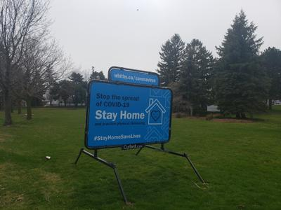 Stay Home sign at Centennial Park